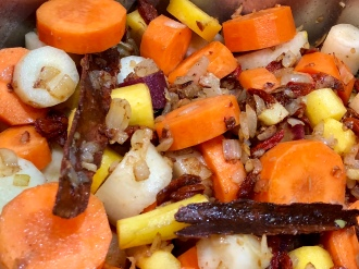 Saute carrots with onions and spices