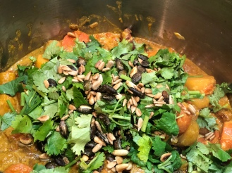 Roasted seeds and fresh coriander to serve